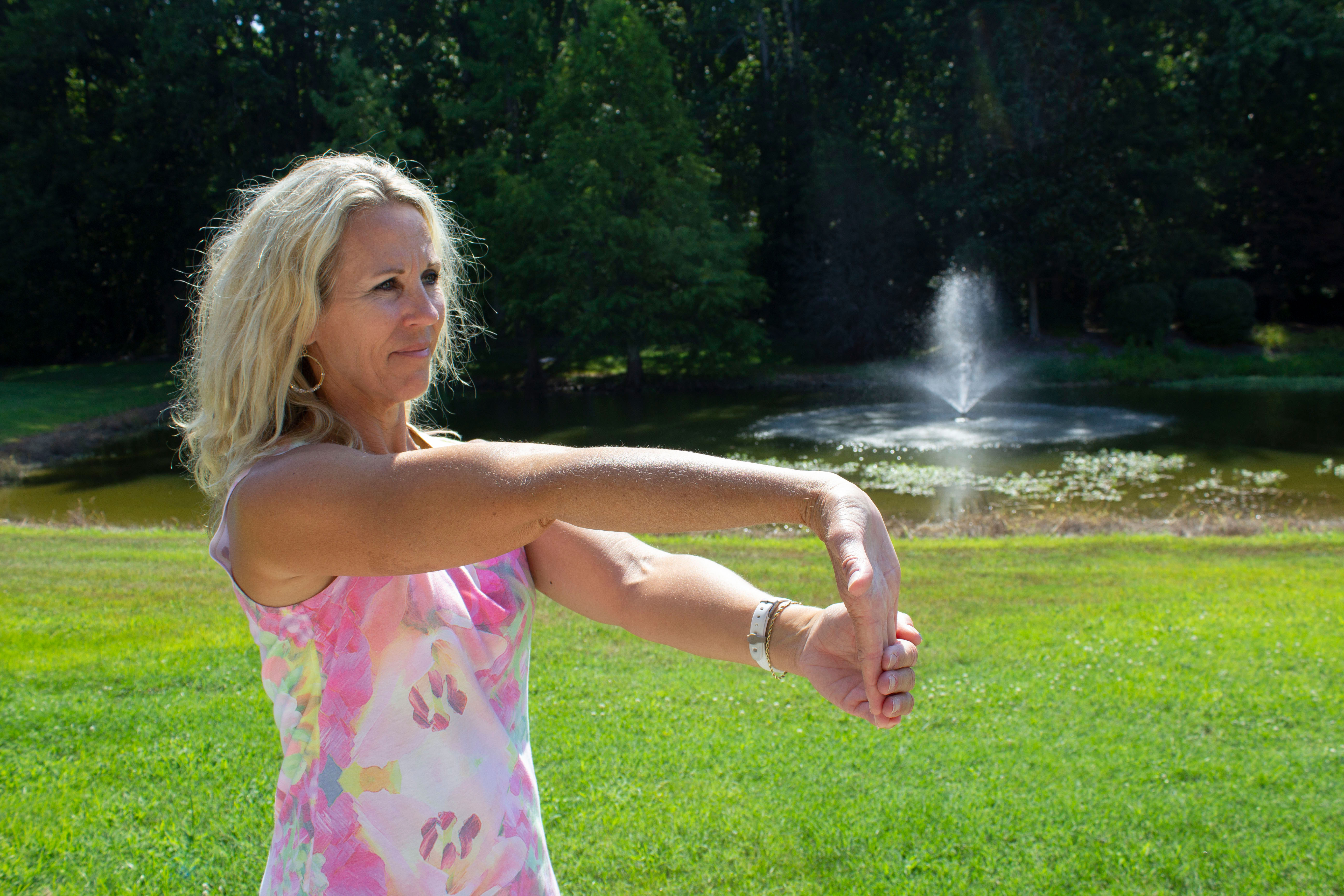 woman stretching arm and wrist