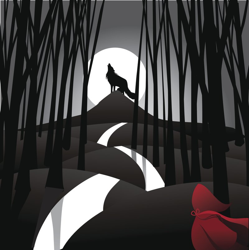wolf standing on a hill