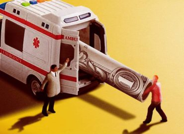 toy men putting dollar into ambulance