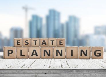 wooden letter blocks spell estate planning