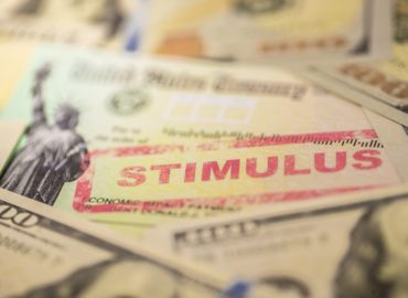Money Stamped with Word Stimulus